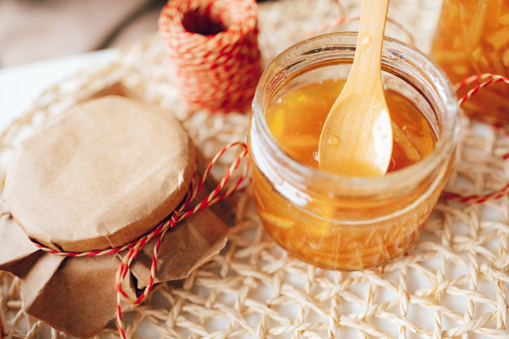 Honey in a jar with wooden spoon inside